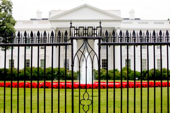 The White House is visible through the fence at the North Lawn in Washington, Thursday, June 16, 2016. A plan to increase the overall height of the fence surrounding the White House by approximately 6 feet, about doubling its current height, has received preliminary approval from a Washington arts commission. (AP Photo/Andrew Harnik)